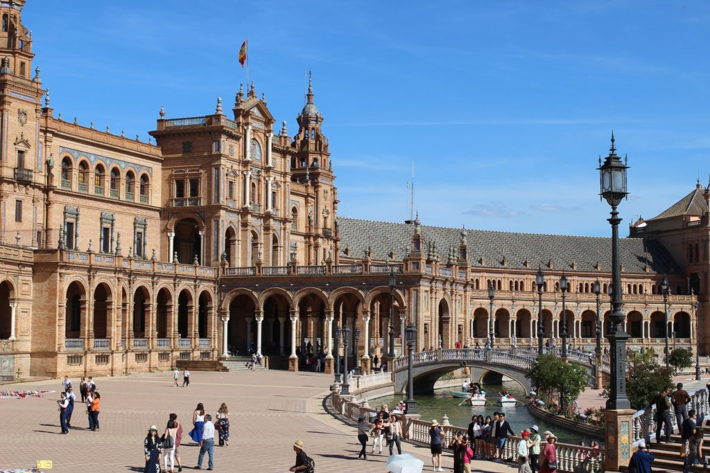 People on a sunny day in plaza de España in Seville